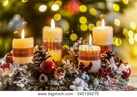 Advent wreath with four white burning candles christmas ball and decorations on a wooden background with festive atmosphere. stock photo