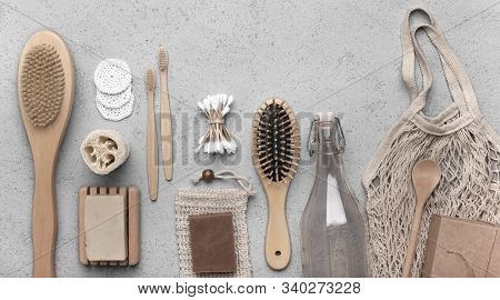 Zero waste bathroom accessories and reusable eco net bag on gray background, panorama stock photo