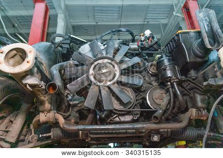 Close-up of a car engine with fan blades on the car. Concept of repair, auto Assembly stock photo
