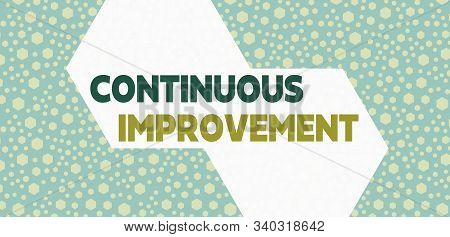 Handwriting text writing Continuous Improvement. Concept meaning ongoing effort to improve products or processes Randomly Scattered Blue Hexagons Seamless Sexangles Matching Background. stock photo