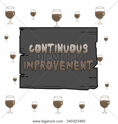 Text sign showing Continuous Improvement. Conceptual photo ongoing effort to improve products or processes Wooden square plank empty frame slots grooves wood panel colored board lumber. stock photo