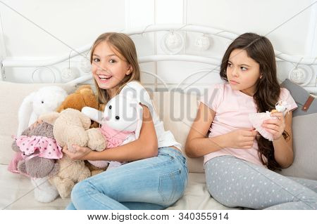 Thats not fair. Small children quarrel over toys. Quarrel and toy fighting. Sibling rivalry. Family relationship. Friends and friendship problem. Quarrel and conflict. Fair sharing brings no quarrel. stock photo