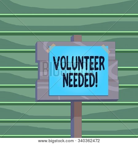 Conceptual hand writing showing Volunteer Needed. Business photo showcasing asking demonstrating to work for organization without being paid Wood plank wood stick pole paper note attached adhesive tape. stock photo