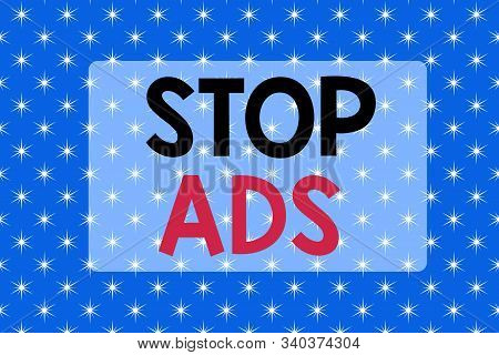 Writing note showing Stop Ads. Business photo showcasing program that will remove different kinds of advertising from Web Abstract blue fantasy stars design background Gift wrapping paper. stock photo