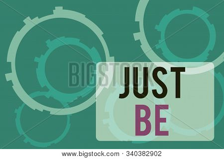 Text sign showing Just Be. Conceptual photo to do the things you believe in and want to be accepted for Abstract Texture background with gears plain color behind. Gradient Pattern. stock photo