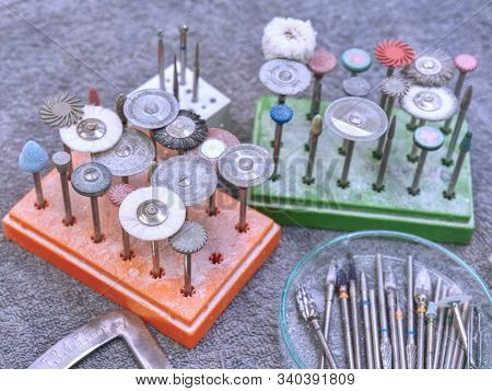 Special dental tools drill burrs and denture polishers in holder on a dentist table stock photo