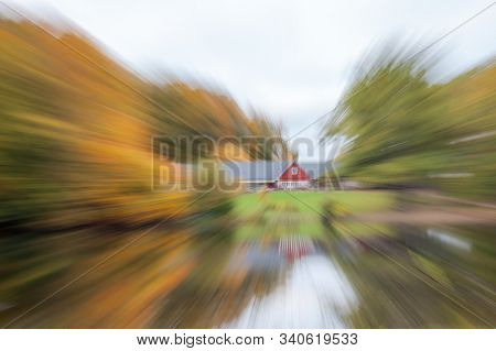 Abstract photo, The house is surrounded by an autumn forest, standing on the shore of a lake. photographed with different effects of motion and zoom. Colorful textured background. long shutter speed. stock photo