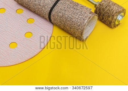 Set of abrasive tools and sandpaper on yellow background the wizard is used for grinding items stock photo