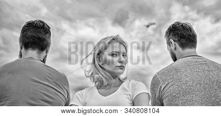 Best traits great boyfriend. Girl thinking whom she going ask dating. Everything need know about choosing right guy. Girl stand in front two faceless men. Pick better boyfriend. Hard decision for her stock photo