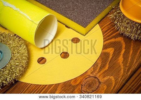 Set of abrasive tools and sandpaper on vintage wooden background wizard is used for grinding items stock photo