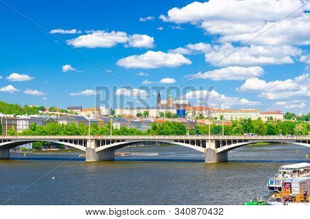 Aerial panoramic view of Prague city, historical center with Prague Castle, St. Vitus Cathedral, Hradcany district, bridges over Vltava river, blue sky white clouds background, Bohemia, Czech Republic stock photo
