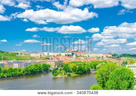 Aerial panoramic view of Prague city, historical center with Prague Castle, St. Vitus Cathedral in Hradcany district, Strelecky island, Vltava river, blue sky white clouds, Bohemia, Czech Republic stock photo