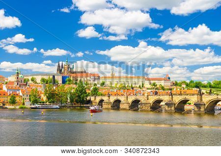 View of Prague old town, historical center with Prague Castle, St. Vitus Cathedral in Hradcany district, Charles Bridge Karluv Most, Vltava river, blue sky white clouds, Bohemia, Czech Republic stock photo