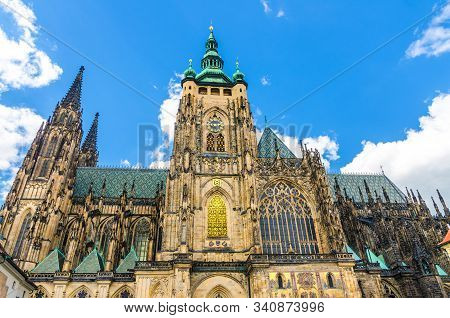Golden Gate South Tower with clock - exterior of St. Vitus Cathedral or The Metropolitan Roman Catholic Cathedral in Prague Castle Hradcany Lesser Town district, Bohemia, Czech Republic stock photo