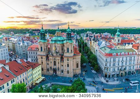 Top aerial view of Prague Old Town Square (Stare Mesto) historical city centre. Former market square. Catholic Church of Saint Nicholas, evening view. Bohemia, Czech Republic stock photo