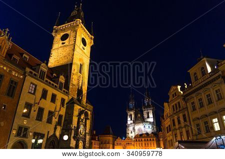 Prague Old Town Square (Stare Mesto) historical city centre. Astronomical Clock (Orloj) and Tower of City Hall building, Gothic Church of Our Lady before Tyn, night view, Bohemia, Czech Republic stock photo