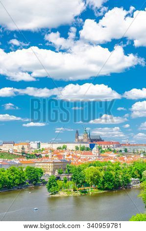 Aerial vertical view of Prague city, historical center with Prague Castle, St. Vitus Cathedral in Hradcany district, Strelecky island, Vltava river, blue sky white clouds, Bohemia, Czech Republic stock photo