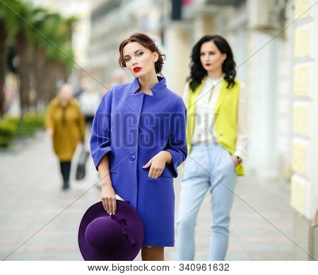 Stylish women model 20-25 years old on a square in a European city. stock photo