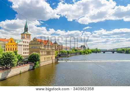 Bedrich Smetana Museum on the bank of Vltava river in Prague old town historical city center, view from Charles Bridge Karluv Most, blue sky white clouds background, Bohemia, Czech Republic stock photo
