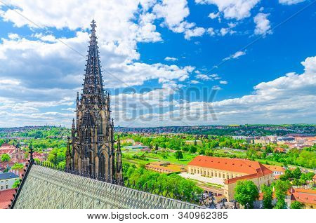 Top aerial view of Prague Royal Garden and roof and spire of St. Vitus cathedral, blue sky white clouds background, Bohemia, Czech Republic stock photo