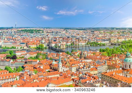Top aerial panoramic view of Prague historical city centre with red tiled roof buildings in Mala Strana Lesser Town and Old Town, Charles Bridge Karluv Most over Vltava river, Bohemia, Czech Republic stock photo