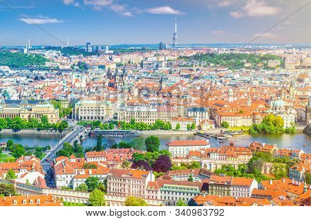 Top aerial panoramic view of Prague historical city centre with red tiled roof buildings in Mala Strana Lesser Town and Old Town districts, Manes bridge over Vltava river, Bohemia, Czech Republic stock photo