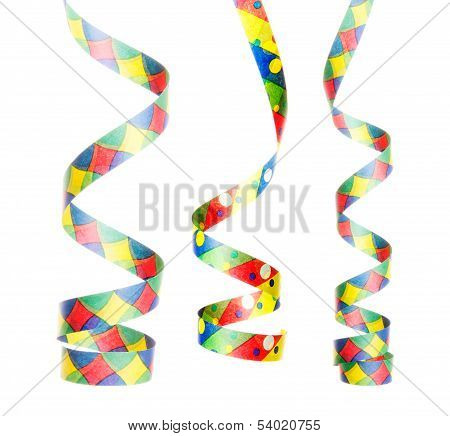 streamers as decoration for parties sylvester isolated hanging with white background stock photo