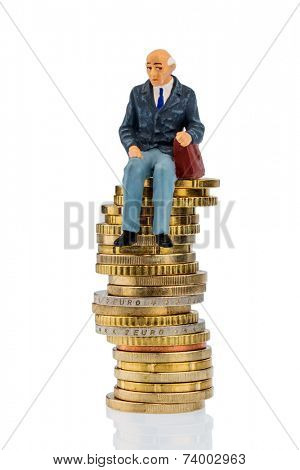 pensioners sitting on a pile of money, symbolic photo for pension, retirement, pension stock photo