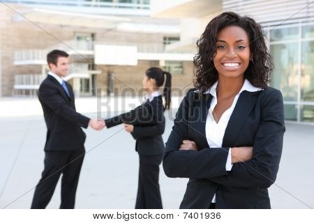 A diverse attractive man and woman business team at office building stock photo