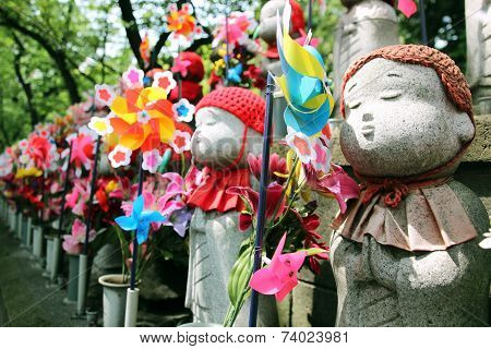 Jizo statues at shinto temple. These statues are a ceremony for those who have had a miscarriage stillbirth or abortion stock photo