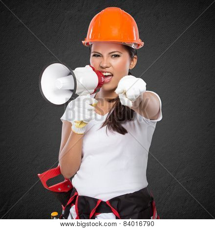 portrait of Female Construction Worker With Toolbelt south on megaphone stock photo