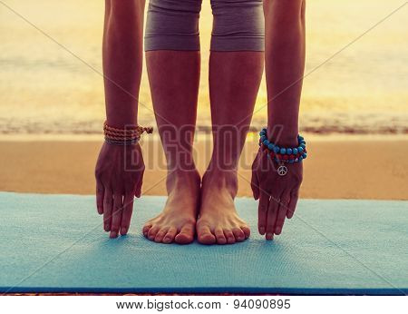 Girl Doing Yoga Exercise On Beach