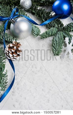 Close up of silver and blue christmas balls on snowy fir branch. Xmas decoration with pine cone and -Lg Fridge Magnet Skin (size 36x65)
