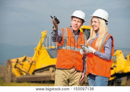 construction co-workers discussing about work plan construction site stock photo