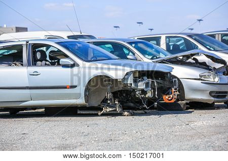 several cars in a scrap yard available for spare parts stock photo