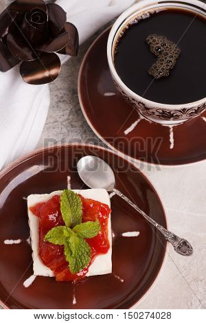 Brazilian dessert Romeo and Juliet goiabada jam of guava and cheese Minas with cup of coffee on marble table. Selective focus stock photo