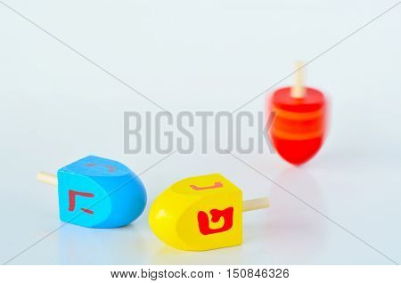 Dreidels (sevivons) during the Jewish holiday of Hanukkah. It is a four-sided spinning top played with during the Jewish holiday of Hanukkah. Holiday concept with copy space stock photo