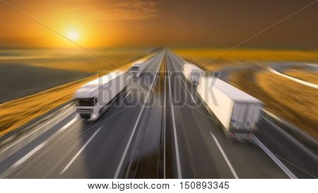 Temperature controlled reefer trucks driving towards the sun. Fast blurred motion image on the freeway at beautiful sunset. Freight scene on the motorway near Belgrade Serbia. stock photo