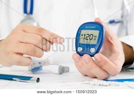 Doctor making blood sugar test. Healthcare diabetes sugar medical concept stock photo