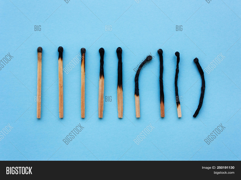 aging,ash,background,black,burn,burned,burning,burnout,burnt,closeup,color,concept,danger,dangerous,depression,destructive,extinction,fire,flame,idea,ignition,illness,isolated,light,match,matches,matchstick,nobody,red,risky,small,stick,wood,wooden