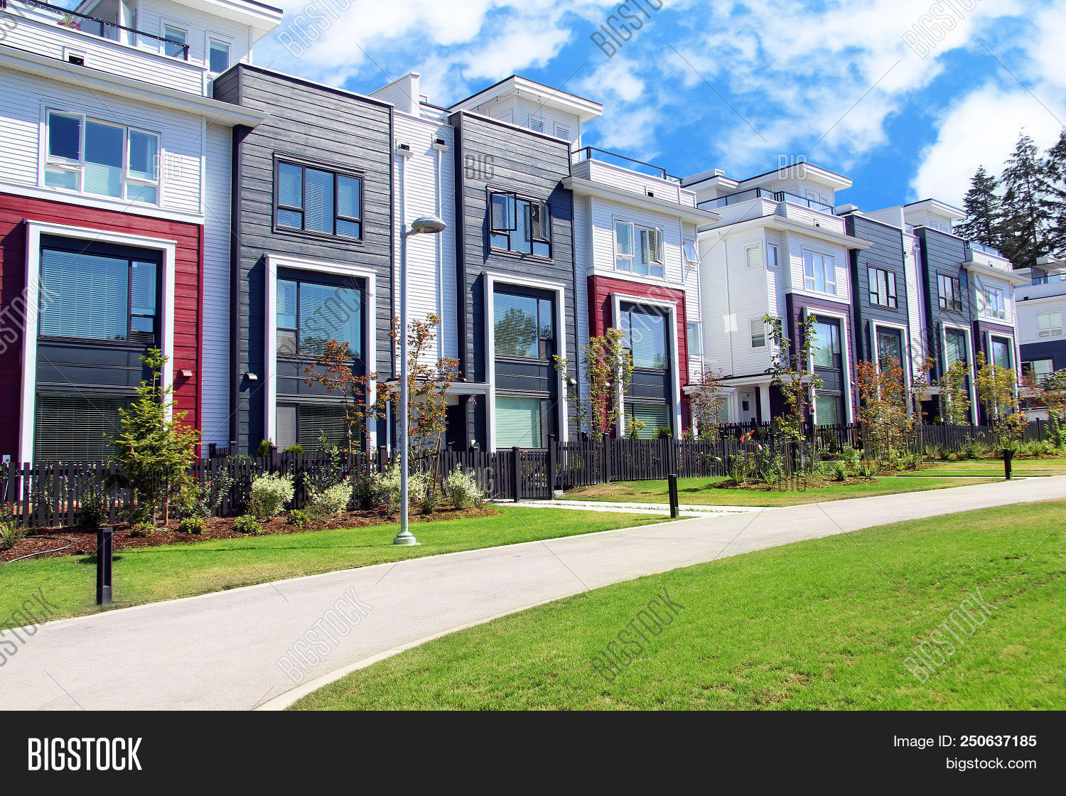 Beautiful new contempory suburban attached townhomes with colorful summer gardens in a Canadian neig