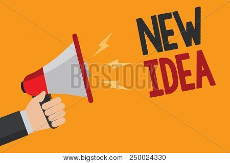Handwriting text writing New Idea. Concept meaning A thought or conception refer to a product of mental activity Man holding Megaphone loudspeaker loud screaming talk talking speech listen stock photo