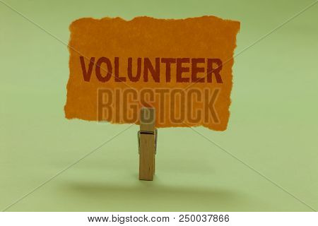 Writing note showing Volunteer. Business photo showcasing Volunteering individual for greater social cause serving others Nice lime colour grey shadow art work board important clip paperclip stock photo