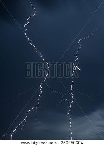 The discharge of lightning in the sky as a background . stock photo