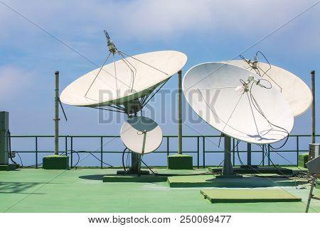 Satellite dishes antenna or radio antennas on roof stock photo
