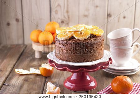 Homemade cupcake with tangerines on a white plate, for breakfast. cups for tea. wooden background, space for writing text or advertising stock photo