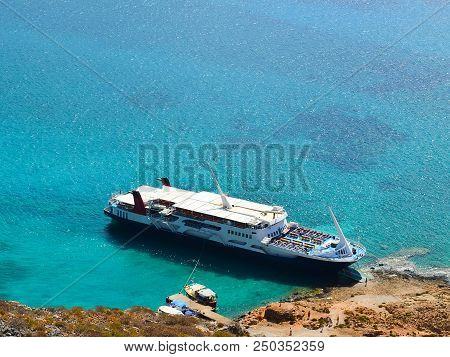 A pleasure boat in a picturesque bay on the Mediterranean Sea, top view. Bay Balos near the Greek island Gramvous stock photo