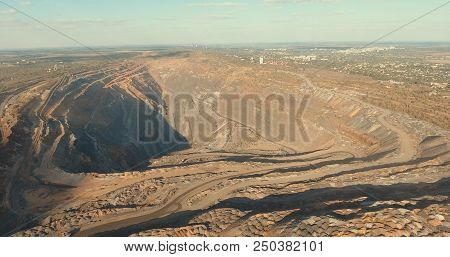 aerial photography. view of the quarry from above. depth of quarry. multistage industrial quarry stock photo