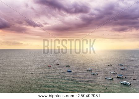 Puerto Vallarta, a resort town in Mexico, is famous by it's sunsets. This picture was taken above Los Muertos beach, close to the pier called Mirador. stock photo