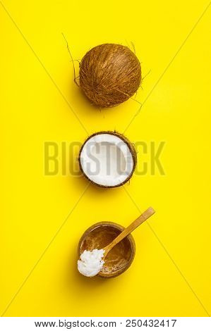 Coconut oil and fresh coconuts, flat lay stock photo